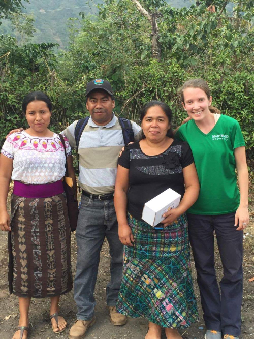 Student with clients in Guatemala
