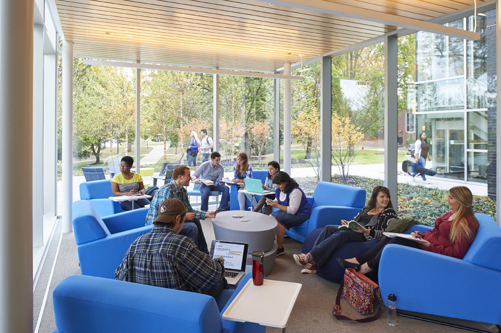 learning commons blue chairs with students studying