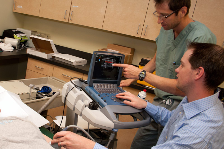 faculty members using equipment