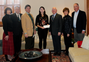 Samantha Adams Receives a check from Representatives of The Friendly Sons of St. Patrick