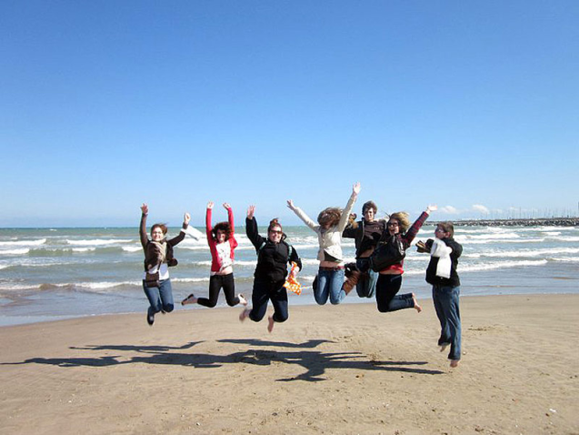 students on beach in spain