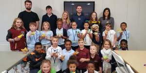 Accounting and Finance Club student members teach children the value of saving