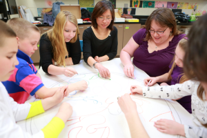 early childhood education students and teachers work on project