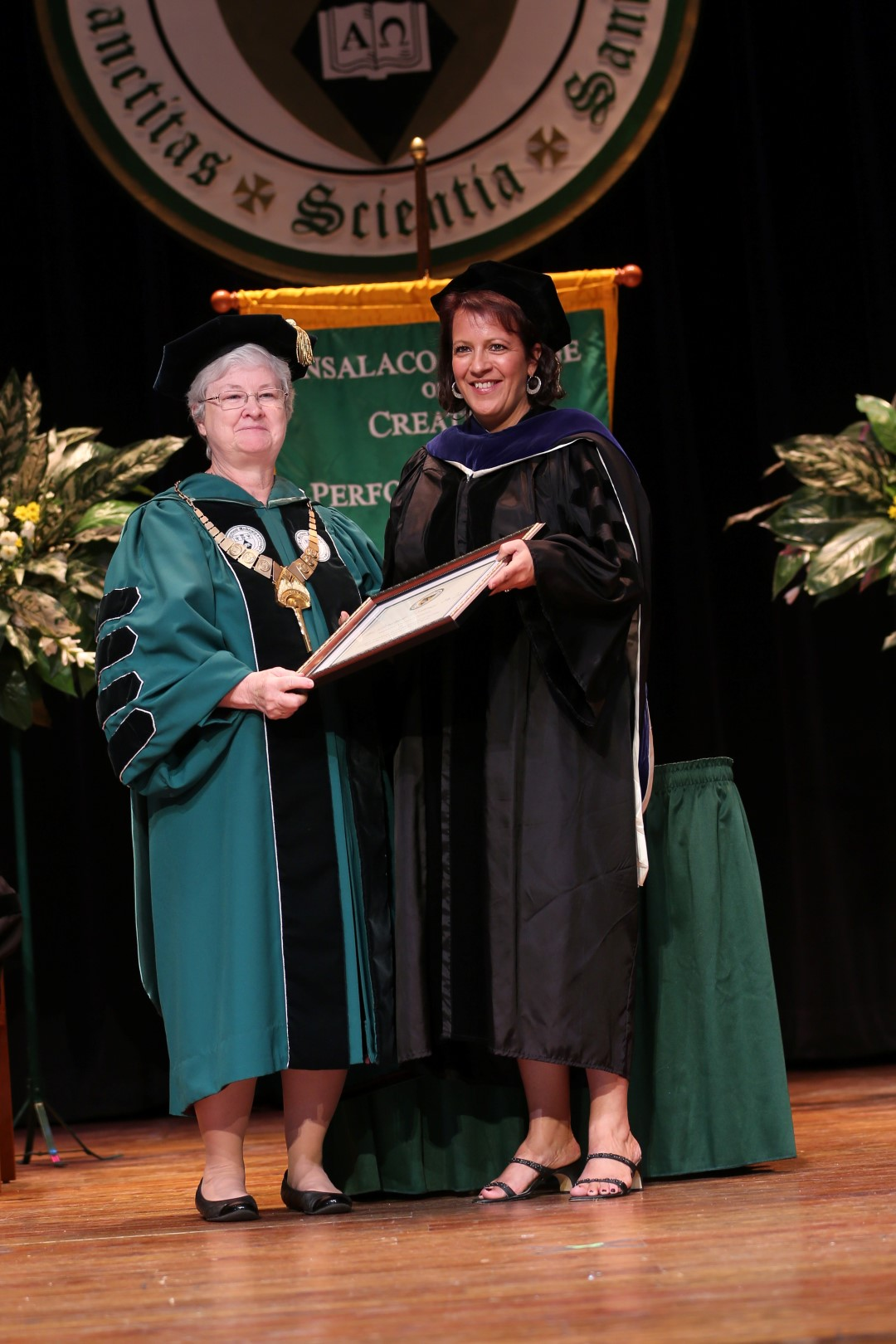 Sister Anne Munley, IHM, President of Marywood University, presents Dr. Ann Cerminaro-Costanzi with the 2013 CASE Award