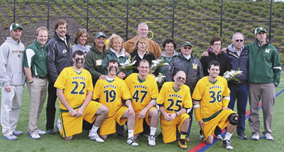 Senior Day, back row (L to R): Volunteer Assistant, Ryan Kearney, Head Lacrosse Coach Scott Dalgliesh, Al and Sue Cornella, Joe and Sharon Frederico, Brian and Eleanor McNamara, Al and Lisa Falco, and David and Margaret Nester, Former Lacrosse Assistant Coach Jeremy Phelps. Kneeling are the Senior players (L to R) Nick Cornella, Dante Frederico, Sean McNamara, Mike Falco, and Greg Nester.