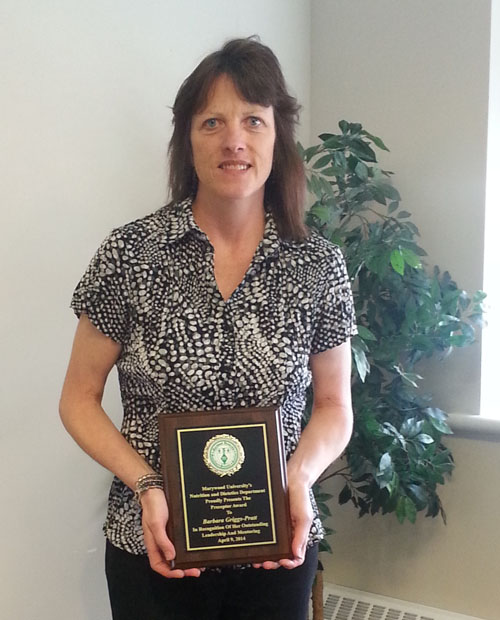 Barbara Griggs-Pratt with award plaque