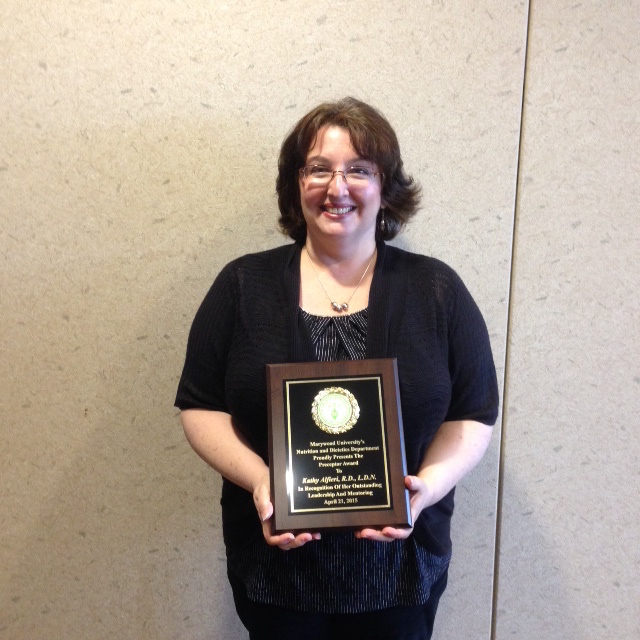 Kathy Alfieri with award plaque