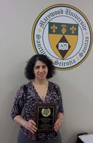 Laurie Waskovich with award plaque