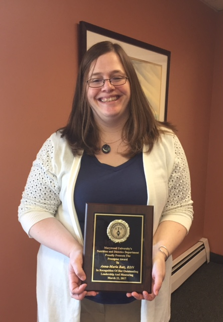 Photo of Anna-Marie Batz with award