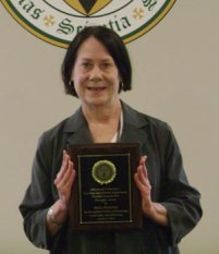 Helen Pickering with award plaque