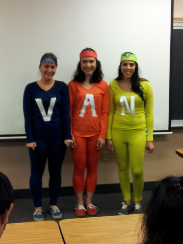 Photo of three students in costume